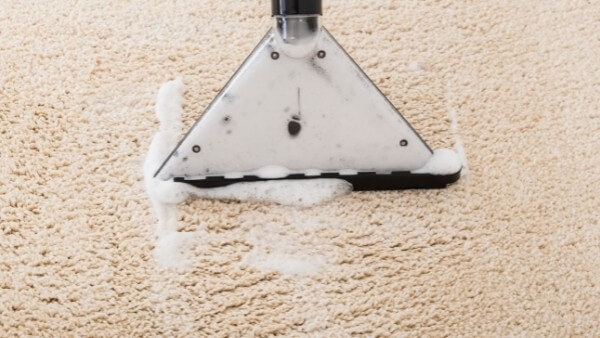 removing grease from carpets cleaning machine